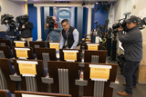 Photos From Fin Gomez, a board member of the White House Correspondent's Association, rearranges seating positions in the White House briefing room to affect social distancing in response to the spread of coronavirus
