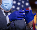 Photo - United States Representative G K Butterfield (Democrat of North Carolina) puts on protective gloves prior to a news conference at the United States Capitol in Washington DC US on Wednesday June 24 2020  Credit Stefani Reynolds  CNPAdMedia