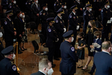 Photo - ShannonTerranova wife of US Capitol Police officer William Billy Evans center and their children Logan Evans right and Abigail Evans left depart following a lying in honor ceremony in the Rotunda of the US Capitol in Washington DC on Tuesday April 13 2021Credit Amr Alfiky  Pool via CNPAdMedia