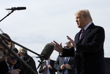 Photo - United States President Donald J Trump speaks to members of the media next to Air Force One at Joint Base Andrews as he departs Washington DC US for Los Angeles California on Tuesday February 18 2020Credit Stefani Reynolds  CNPAdMedia