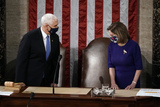 Photo - Speaker of the House Nancy Pelosi D-Calif and Vice President Mike Pence arrive to officiate as a joint session of the House and Senate convenes to count the Electoral College votes cast in Novembers election at the Capitol in Washington Wednesday Jan 6 2021Credit J Scott Applewhite  Pool via CNPAdMedia
