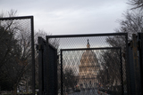 Photo - A metal barricade surrounds the US Capitol as preparations are made for the upcoming inauguration of President Joe Biden at the US Capitol in Washington DC Friday January 15 2021 Credit Rod Lamkey  CNPAdMedia