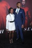 Photo - 19 March 2019 - New York New York - Lupita Nyongo and Winston Duke at Universal Pictures US Premiere at the Museum of Modern Art in Midtown Photo Credit LJ FotosAdMedia