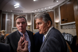 Photo - United States Senator Mark Warner (Democrat of Virginia) and United States Senator Joe Manchin III (Democrat of West Virginia) confer with a staff member while United States Senator Rob Portman (Republican of Ohio) and United States Senator Kyrsten Sinema (Democrat of Arizona) respond to questions from reporters after the vote on the motion to invoke cloture to proceed to the consideration of HR 3684 the INVEST in America Act on Capitol Hill in Washington DC on Wednesday July 28 2021 The vote to begin discussion of the bipartisan infrastructure bill agreed to by the White House was 67 to 32 If passed the bill would invest close to 1 trillion in roads bridges ports and other infrastructure without a major tax increaseCredit Rod Lamkey  CNPAdMedia