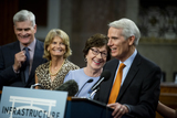 Photo - United States Senator Bill Cassidy (Republican of Louisiana) left United States Senator Lisa Murkowski (Republican of Alaska) second from left and United States Senator Susan Collins (Republican of Maine) second from right share in a laugh while United States Senator Rob Portman (Republican of Ohio) right makes remarks after the vote on the motion to invoke cloture to proceed to the consideration of HR 3684 the INVEST in America Act on Capitol Hill in Washington DC on Wednesday July 28 2021 The vote to begin discussion of the bipartisan infrastructure bill agreed to by the White House was 67 to 32 If passed the bill would invest close to 1 trillion in roads bridges ports and other infrastructure without a major tax increaseCredit Rod Lamkey  CNPAdMedia