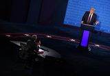 Photo - United States President Donald J Trump speaks with moderator Chris Wallace during the first of three scheduled 90 minute presidential debates with Democratic presidential nominee Joe Biden in Cleveland Ohio on Tuesday September 29 2020Credit Kevin Dietsch  Pool via CNPAdMedia