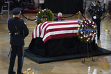 Photo - A person kneels as they pay respects to slain US Capitol Police officer William Billy Evans as he lies in honor at the Capitol in Washington Tuesday April 13 2021Credit Jacquelyn Martin  Pool via CNPAdMedia