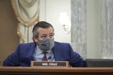 Photo - United States Senator Ted Cruz (Republican of Texas) wears a protective mask while arriving to a Senate Commerce Science and Transportation Committee confirmation hearing for US Secretary of Transportation nominee Pete Buttigieg in Washington DC US on Thursday Jan 21 2021 Buttigieg is pledging to carry out the administrations ambitious agenda to rebuild the nations infrastructure calling it a generational opportunity to create new jobs fight economic inequality and stem climate change Credit Stefani Reynolds  Pool via CNPAdMedia