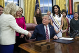 Photo - US President Donald J Trump signs bills during a ceremony in the Oval Office of the White House