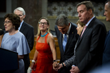 Photo - United States Senator Kyrsten Sinema (Democrat of Arizona) left reaches out to hold the hand of United States Senator Jeanne Shaheen (Democrat of New Hampshire) while United States Senator Susan Collins (Republican of Maine) left makes remarks after the vote on the motion to invoke cloture to proceed to the consideration of HR 3684 the INVEST in America Act on Capitol Hill in Washington DC on Wednesday July 28 2021 The vote to begin discussion of the bipartisan infrastructure bill agreed to by the White House was 67 to 32 If passed the bill would invest close to 1 trillion in roads bridges ports and other infrastructure without a major tax increaseCredit Rod Lamkey  CNPAdMedia