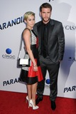 Photo - 8 August 2013 - West Hollywood California - Miley Cyrus Liam Hemsworth Paranoia Los Angeles Premiere held at the Directors Guild of America Photo Credit Byron PurvisAdMedia