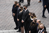 Photo - Family members stand as they wait to watch the flag-draped casket of Justice Ruth Bader Ginsburg is carried by a joint services military honor guard after Ginsburg lied in state at the US Capitol Friday Sept 25 2020 in WashingtonCredit Alex Brandon  Pool via CNPAdMedia
