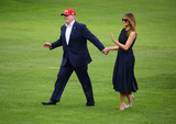 Photos From United States President Donald J. Trump and first lady Melania Trump Return from Europe