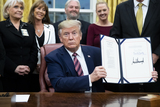Photos From US President Donald J. Trump signs a bill during a ceremony in the Oval Office of the White House