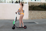 Photo - Rena Riffelthe Showgirls star is spotted in a tiny yellow bikini riding an electric scooter near the beach in Marina Del Rey CA 09-19-18