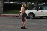 Photo - Brazilian Playmate Ana Braga seen jaywalking in a risque outfit