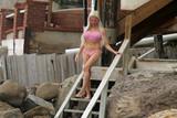 Photo - Frenchy Morgan in a tiny pink bikini on Malibu Beach