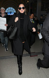 Photo - Chrissy Teigen is seen at LAX Airport