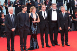 Louis Garrel Photo - VENICE ITALY - AUGUST 30 (L-R) Alain Goldman Louis Garrel Emmanuelle Seigner Jean Dujardin Luca Barbareschi and Paolo Del Brocco walk the red carpet ahead of the JAccuse (An Officer And A Spy) screening during the 76th Venice Film Festival at Sala Grande on August 30 2019 in Venice Italy(Photo by Laurent KoffelImageCollectcom)