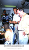 Richard M Daley Photo - Arnold Schwarzenegger National Chairman Inner-city Games Flexes His Muscles in LA 8162000 Here He Helps a Boy at the Hollenbeck Youth Center at the Computer Chicago Mayor Richard M Daley Looks on Photo by Paul SkipperGlobe Photos Inc2000
